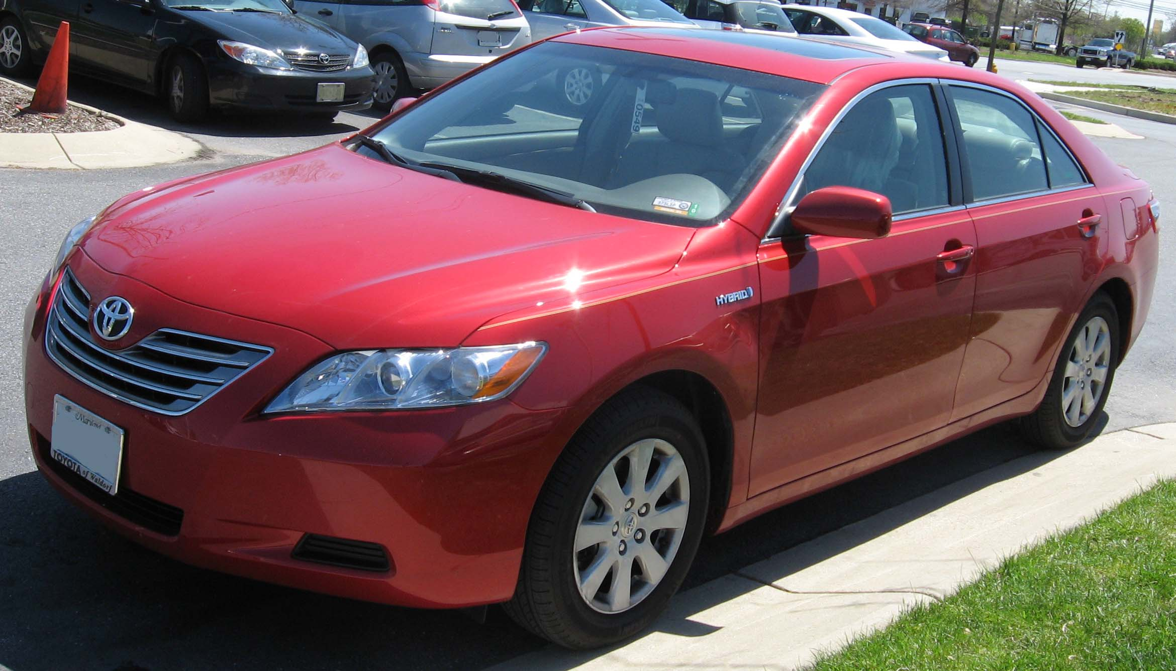 man facing midlife crisis buys red toyota camry. Black Bedroom Furniture Sets. Home Design Ideas